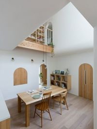 The ground floor of Outsu House in Japan is laid out over split levels, emphasising the separation between different rooms.