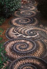 Swirl pebble mosaic path. Wow, this would be magical in a garden