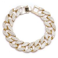 GOLD-PLATED CHUNKY CUBAN LINK BRACELET WITH BLING (2 ROWS) Special Features: Chunky gold-plated chain with clear crystals Dimensions: Length : 8 inches, Width : 16mm