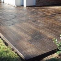 scored and stained concrete to look like wood floors on the patio by kelli