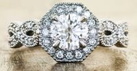 This is my dream ring if it wasn't a halo. I love the vintage look and infinity band. Click and look at the inside and side detail!! Daniee March 2013