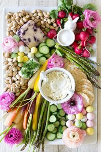 This Easter Cheese and Crudites Board is the perfect appetizer to set out for family before Easter dinner. It's bright, fresh, and full of fresh spring flavors