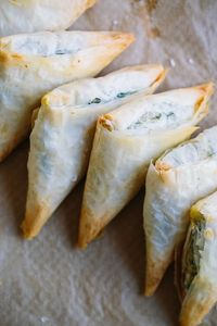 Spanakopitas with swiss chard, chickpeas, and olives wrapped in flaky phyllo