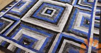Piece N Quilt: A Masculine Quilt with Edge to Edge Machine Quilting