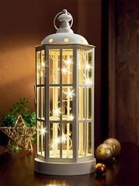 White lantern + string of white Christmas lights