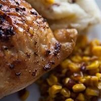 Moist Garlic Roasted Chicken Allrecipes.com My husband puts this on the rotisserie. Turn on the two side burners leaving the middle one off. Start with high heat for 10 minutes to sear the outside. Then turn it down to medium-low. It's so moist and th...