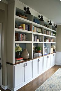 DIY built in bookcases butcher block. Bases made from upper kitchen cabinets
