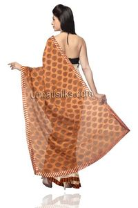 This beige cream and orange color banarasi supernet saree is simply elegant.