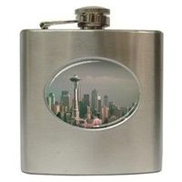 Grey Seattle Focus Shift Hip Flask by stineshop $23.99  Digital art, Seattle skyline in grey with focus shift (blurry) effect.  Product Details The brushed chrome metal finish makes this hip flask a quality gift for those who enjoy a drink a...