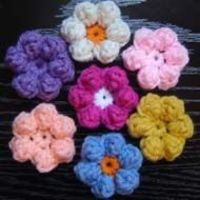 Puffy Daisy Flower Crochet Pattern Almost the same as the blue flower baby blanket. But instead of the dc,treble,dc for the petal. You do 5 trebles but yarn over 4 times instead of just 2. Ch3 and slip stitch.