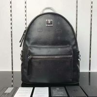 MCM Small Stark Side Odeon Studs Backpack In Black