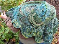 Interesting technique. Knit (not crochet) in half circles using k, p & yo. Great stash buster too. (US$20 ebook on Ravelry)