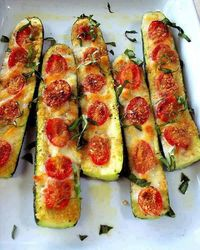 Zucchini Pizza Sticks Low carb!...YES!! talk about yummy! SIMPLE & EASY... Slice the zucchini in half. Slice off the bottom to keep in stable. Brush with olive oil and top with garlic or garlic powder. Top with sliced tomatoes, salt and pepper to tast...