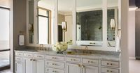 Love how the brass fixtures look against the grey-beige cabinets in the master bath - Tobi Fairley Interior Design