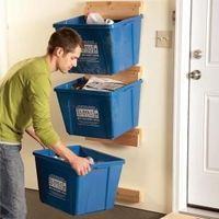Recycling bins can take up way too much floor space in the kitchen or mudroom. Here's an easy project that will get them up off the floor and out of the way, an