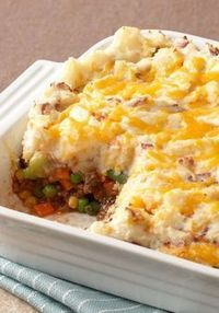 """Updated Shepherds Pie �€"""" This Healthy Living version of a traditional shepherd's pie recipe is made with simple ingredients including all your family's dinnertime favorites�€""""garlic mashed potatoes, peas, carrots, and melted..."""