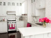 great for a small space - white cabinets stainless steel range tonal grey gray damask wallpaper white countertops lacquer floors fuchsia accessories carrara marble subway tile backsplash peninsula