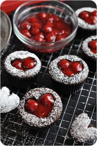 The cupcake version of a classic Valentine's candy, the cherry cordial - dark chocolate cupcakes, dark chocolate ganache, cordial cream and sweet cherries!