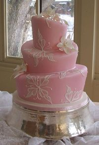 Soft pink mad hatter cake. Cute for a wedding shower