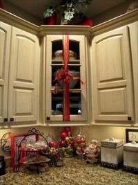Wrap ribbon with a bow around kitchen cabinets