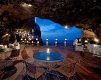 Cave restaurant is located underneath the Grotta Palazzese hotel in a small town of Polignano a Mare, Italy. The customers can eat delicious Italian food and look at the sea.