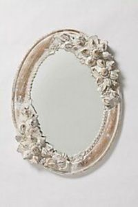 shabby chic inspired. I made a mirror similar to this by using a thrift store mirror, repainting it with white spray paint. It is a great piece in my home!