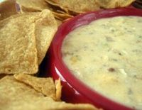 Spicy Sausage & Beer Cheese Dip Recipe, easy dip made in a slow cooker with sausage, green pepper, onion, beer, and cheese.