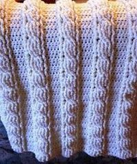 Learn how to make this Cable Baby Blanket with a cable stitch that doesn't require joining squares. Once you have the basic stitch down, you can work up this ad