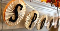 DIY accordion paper banner (shown as Halloween, but could be any color combo) ... http://thecraftingchicks.com/2010/09/spooky-accordian-halloween-banner.html