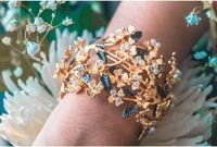 Gold plated Hand-crafted Lightweight A perfect statement piece  Bombay Sunset guarantees, internally and within its supply chain, respect for standards of Social & Environmental Responsibility in line with its sustainability values Nidhi gets ins...