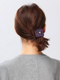 cute side pony with a twist for short hair.