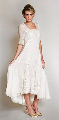 If this were another color (light blue or green....maybe a coral?) it would be a perfect wedding dress....should we ever take that plunge. Love this!