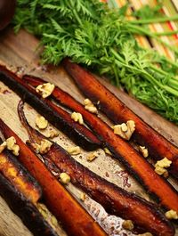 Got to make this! Pomegranate Molasses Glazed Carrots with Walnuts www.fooddonelight.com