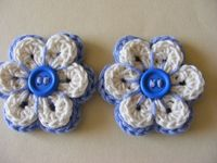 """These """"Crochet Flower Appliqués"""" are for sale but they would be easy to make...I love the button center."""
