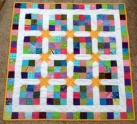 The Rainbow Star Quilt Tutorial is the perfect quilt for a nursery. This quilt design is great for baby's developing eyes, with its many colors and patchwork la