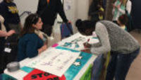 Discussing minimum wage at the Teen Job Fair
