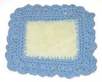 How to make a recycled mesh pot scrubber, from an onion or similar mesh bag, with a crocheted cotton thread edging.