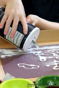 Draw a picture with glue, sprinkle salt, dip a paintbrush in water coloring and touch it to the salt...kids will be mesmerized.