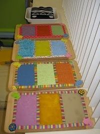 Sensory boards made out of dollar store cutting boards and common objects from the craft cupboard and around the house. There is sand paper - kitchen scrubbies - car wash mitts - place mats - terrycloth toweling - fun fur etc. The edging is made from colo...