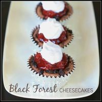 Black Forest Cheesecakes - these super easy mini-cheesecakes with an OREO base are the perfect match of chocolate and cherries. Always a hit at parties!