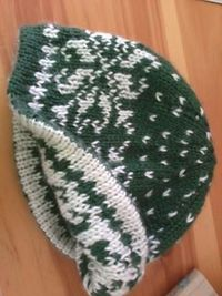 An easy introduction to double-knitting! Worked in worsted-weight yarn on size 5 needles, this hat is a quick, cozy and reversible knit, perfect for the winter chill. Double-knitting means there is no stranding involved in working this lovely snowflake pa...
