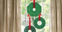 We coated three lightweight polyurethane medallions (from $17 each; outwatercatalogs.com) in rich shades of green and hung them with red satin ribbon for a Victorian-inspired flourish. | Photo: Andrew McCaul | thisoldhouse.com