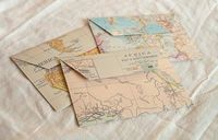 Maps made into envelopes! Idea: Store trip collectibles in maps made of areas traveled