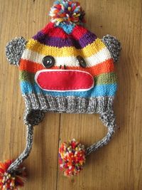 sock monkey hat- this means I have to finish learning how to knit... but it's awfully cute!