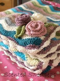 Crochet ripple blanket with scallop edging and roses. Links to patterns and yarn information. Scented Sweetpeas blog