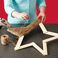 Twine Star using paint sticks!...could wrap lights around it too!, or use letters from hobby lobby