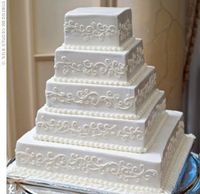 Their five-tiered cake was made with yellow cake, hazelnut filling, and vanilla icing....theknot.com