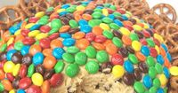 Monster Cookie Dough Dip- egg-less monster cookie dough covered in m&m's. Perfect sweet party dip. www.togetherasfamily.com