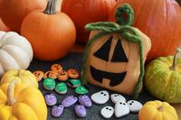 This painted stone tic-tac-toe game is almost as much fun to make as it is to play with.The simple-sew jack-o'-lanternbag doubles as aHalloween decoration and game board (on the back) and...
