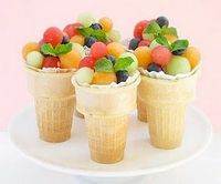 Fruit cups in an ice cream cone--so clever! This would be great for kids and adults! You can never go wrong with fruit salad!